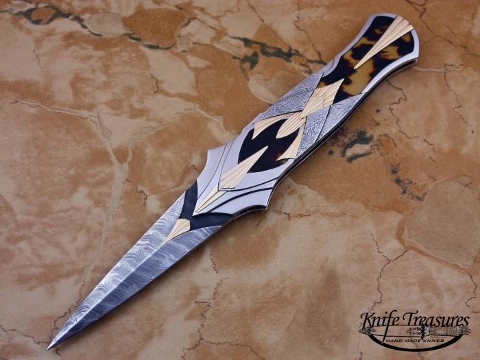 Custom Folding-Inter-Frame, Lock Back, Twist Pattern Damasteel, Exotic Scales Knife made by Ronald Best