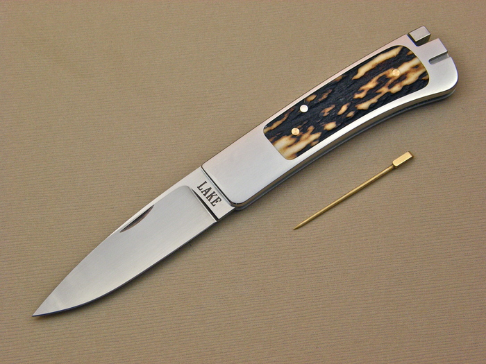 Custom Folding-Inter-Frame, Tail Lock, ATS-34 Steel, Amber Stag Knife made by Ron Lake