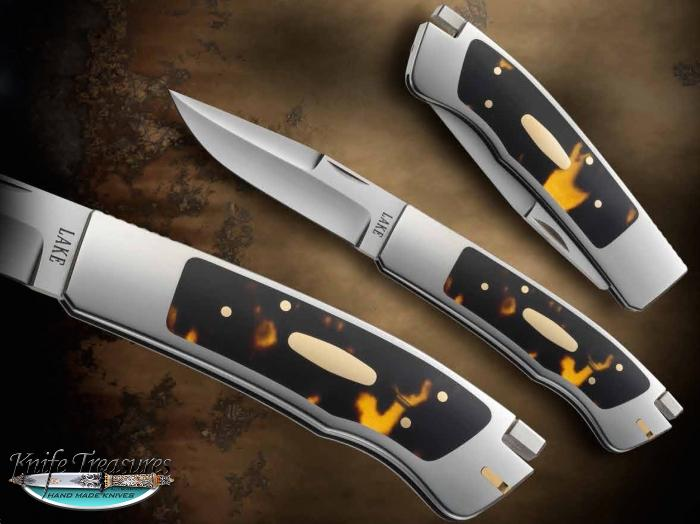 Custom Folding-Inter-Frame, Tail Lock, Un-etched Damascus, Antique Amber Knife made by Ron Lake