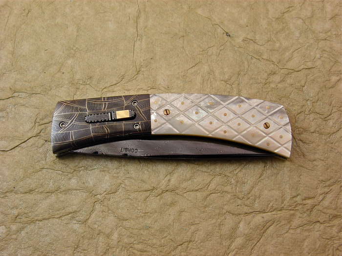 Custom Folding-Bolster, Liner Lock, Blued, Rados Damascus, Checkered Mother Of Pearl with Gold Pins Knife made by Jerry Corbit