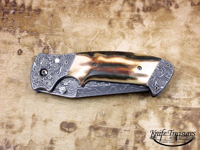 Custom Folding-Bolster, Liner Lock, Vines & Rose Damascus, Fossilized Mammoth Knife made by Pat & Wes Crawford